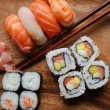 Sushi - Japonese food on a wooden plate — Stock Photo #1227685