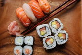 Sushi - Japonese food on a wooden plate — Stock Photo