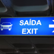 Exit sign on airport — Stock Photo