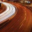 图库照片: Freeway traffic on city (car blur mo