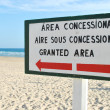 Sign at the beach (granted area) - Stock Photo