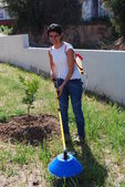 Young farmer fertilizing the soil — Stock Photo
