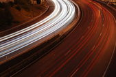 Freeway traffic on the city (car blur mo — Stock Photo