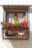 Typical window balcony with flowers in L — Stock Photo
