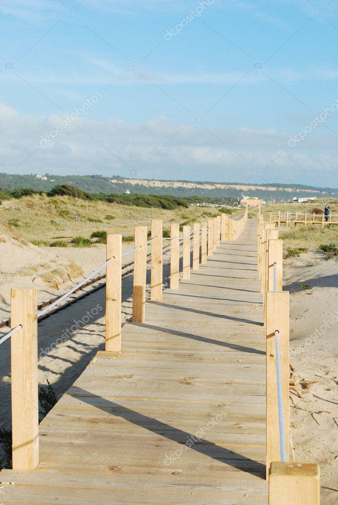 Beautiful boardwalk through the dunes entering local beach  Stock Photo #1261202