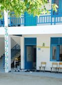 Blue Maldivian school with trainers outs — Stock Photo