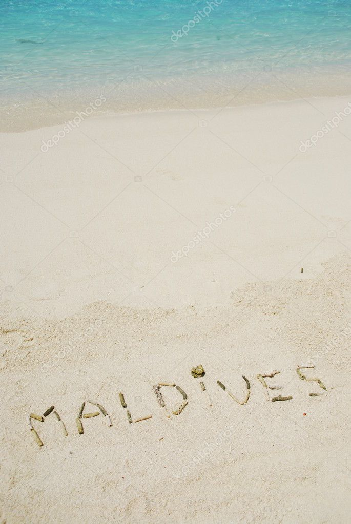 Maldives note written on a white sandy beach — Stock Photo #1299686