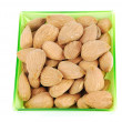Bunch of almond nuts on a green cup — Stock Photo