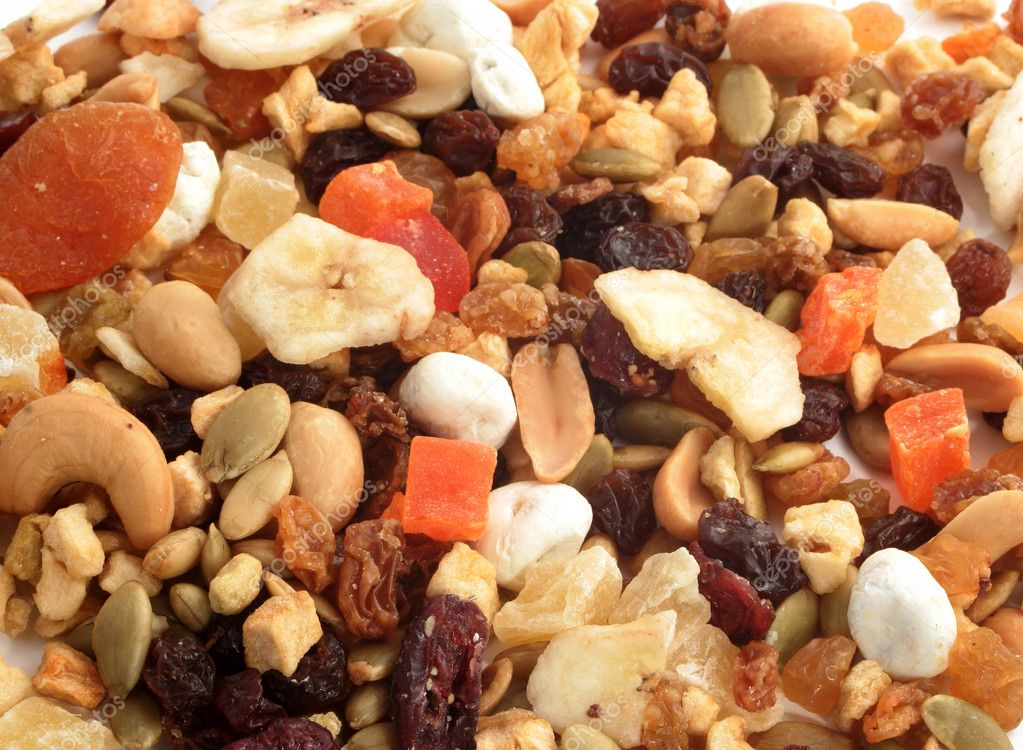 Closeup of delicious and healthy mixed dried fruit, nuts and seeds great for a background — Stock Photo #1969678