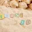 Royalty-Free Stock Photo: Thank you on sand