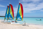 Tropical beach sailboats — Stock Photo