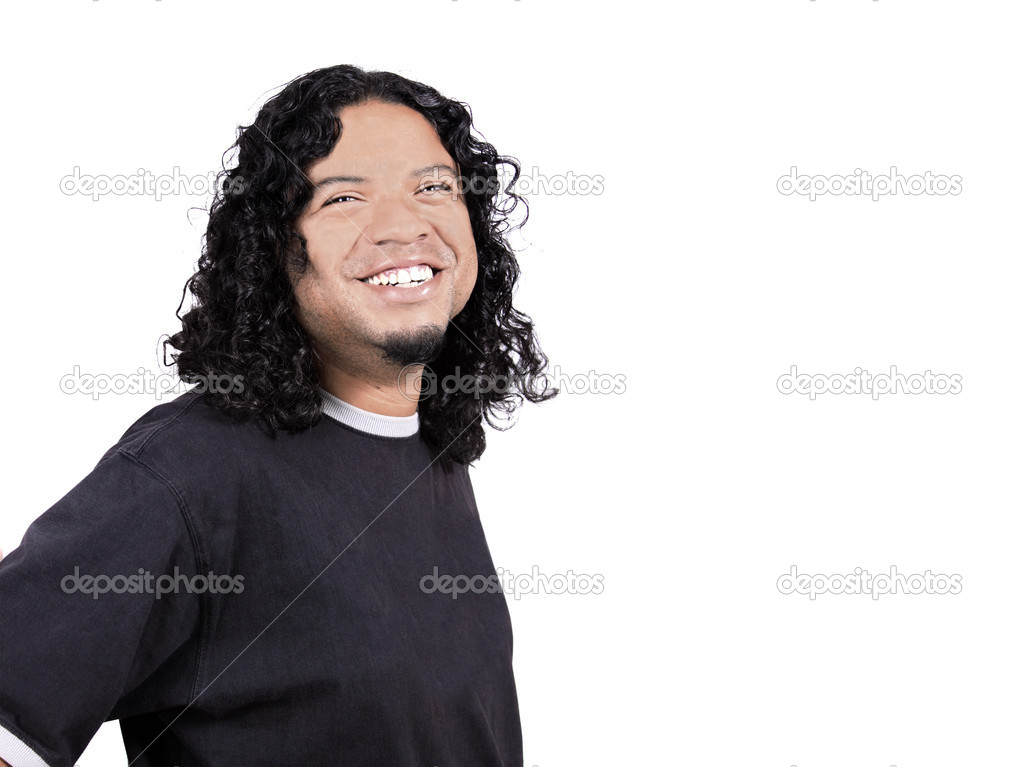 Multi-racial male with big white teeth smile and long curly hair on a white background with copy space — Stock Photo #1976594