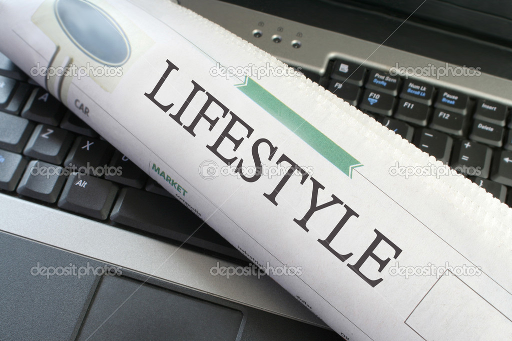 Lifestyle section of the newspaper laying on keyboard of a laptop — Stock Photo #1977511