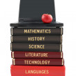 School subject books and laptop — Stock Photo