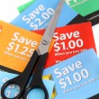 Stock Photo: Coupon clipping