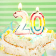Stock Photo: Slice of twentieth birthday cake