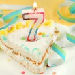 Stock Photo: Slice of seventh birthday cake