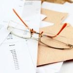 Bills and glasses — Stock Photo