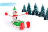Sledding snowman — Stock Photo