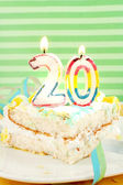 Slice of twentieth birthday cake — Stock Photo