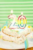 Slice of twentieth birthday cake — Stock Photo
