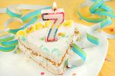 Slice of seventh birthday cake — Stock Photo