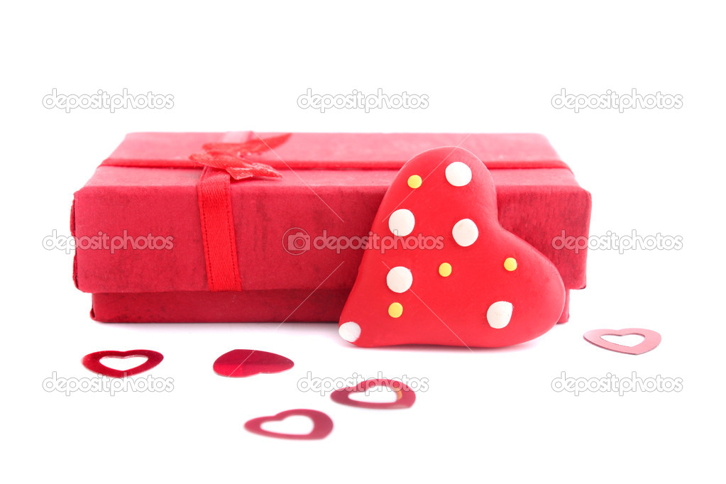 Red Valentine heart and present on a white background — Stock Photo #1980147