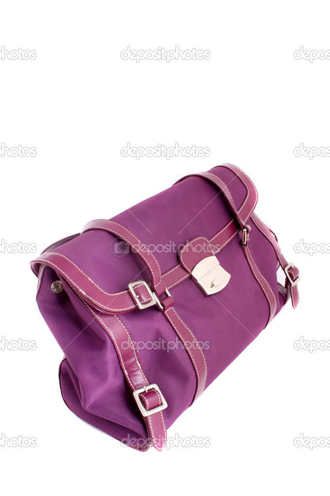 Fuschia colored designer handbag on a white background — Stock Photo #1981948