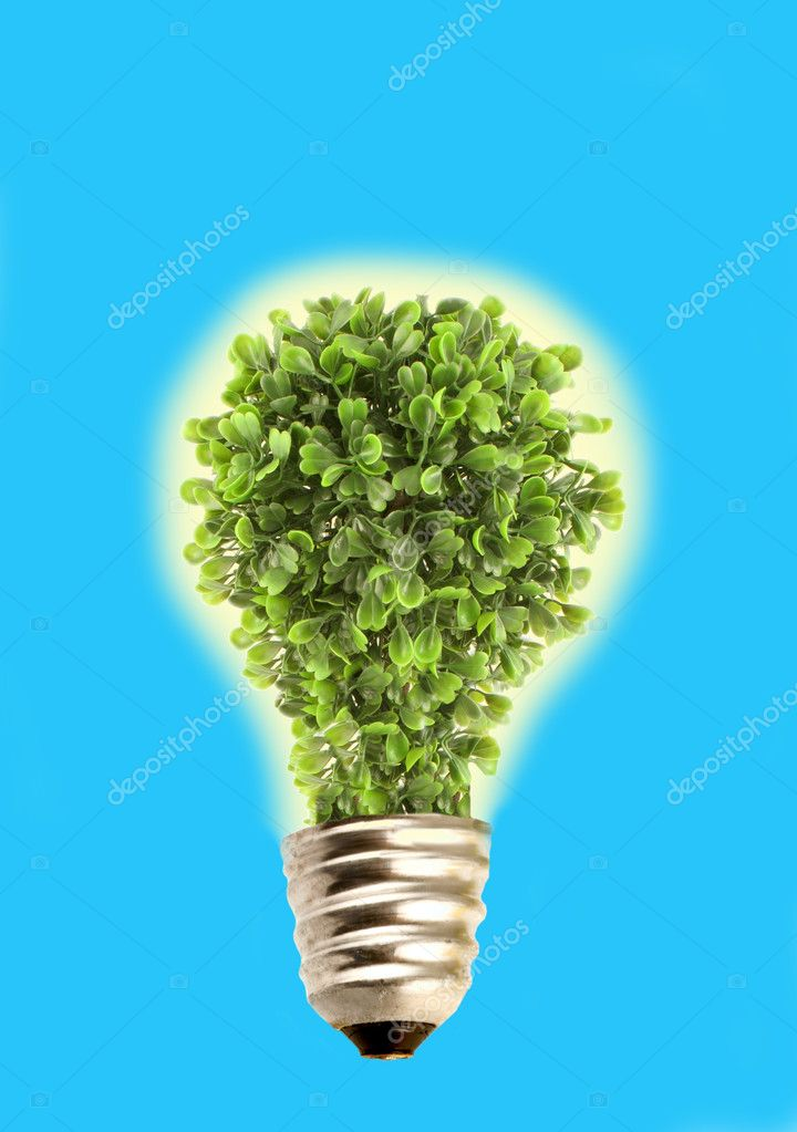 Glowing tree in lightbulb socket symbolizing ecology and eco environmental friendly energy on sky blue background  Stock Photo #1984114