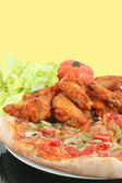 Pizza and chicken wings — Stock Photo