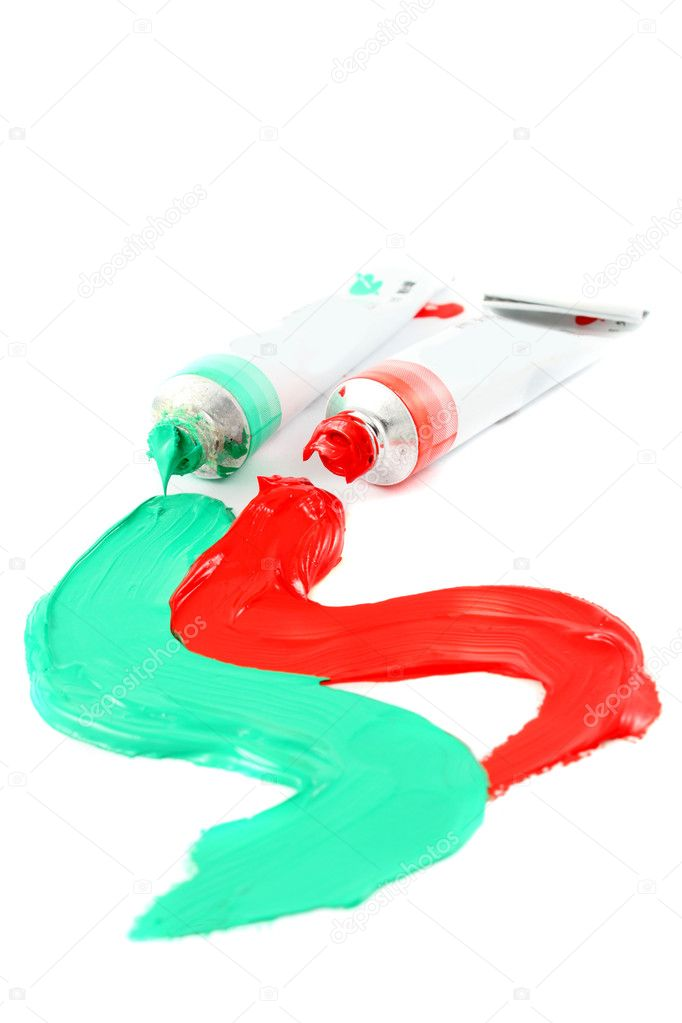 Green and red  colors of artist's oil paints spilling out onto a white  background (Not Isolated and short depth of field) — Stock Photo #2035977