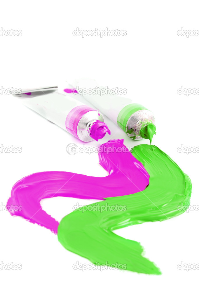 Pink and green colors of artist's oil paints spilling out onto a white  background (Not Isolated and short depth of field)  Stock Photo #2036040