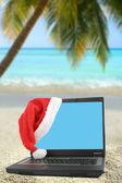 Tropical christmas laptop — Stock Photo