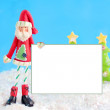 Skinny santa with blank sign — Stock Photo
