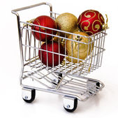 Christmas tree ornament in shopping cart — Stock Photo