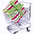 Gift box in shopping cart — Stock Photo #1246535