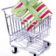 Gift box in shopping cart — Stock Photo #1246625