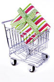Gift box in shopping cart — Stock Photo
