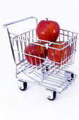 Apples in shopping cart — Stock Photo