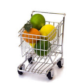 Fruits in shopping cart — Stock Photo
