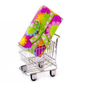 Gift box in shopping cart — Stock Photo