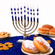 Hanukkah menorah and donuts - Stock Photo