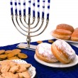 Hanukkah menorah, donuts and coins — Stockfoto