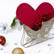 Heart and cranberry in sledge — Stock Photo