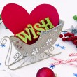 Heart and wish in sledge — Stock Photo