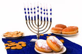 Hanukkah menorah and donuts — Stock Photo