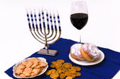 Hanukkah menorah, donuts and coins — Stock Photo
