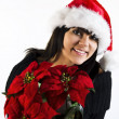 Teen Girl Santa with Poinsettia flower — Zdjęcie stockowe #1292227