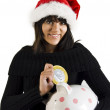 Teen Girl Santa with pig coin box — Stock Photo