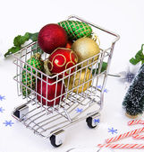 Christmas ornament in shopping cart — Stock Photo